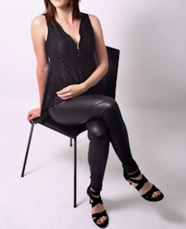 escort rebekha Manchester sitting in chair clothed